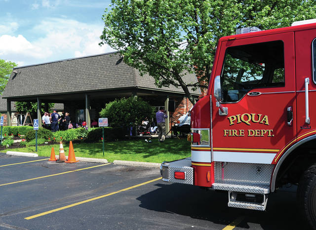 Mike Ullery   Daily Call Piqua Fire Department and Piqua Police Department officers chat with residents at Piqua Manor Nursing Home on Wednesday. The event was in conjunction with National Nursing Home and National EMS Week. Firefighters and police were invited to take lunch with residents.