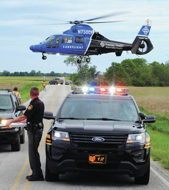 Mike Ullery | Daily Call CareFlight arrives on the scene of a two-vehicle crash at the intersection of Loy and Sodom-Ballou Road on Tuesday afternoon.