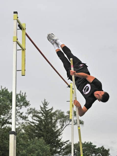 Josh Brown|Civitas Media Covington's Jett Murphy goes over the bar in the pole vault.