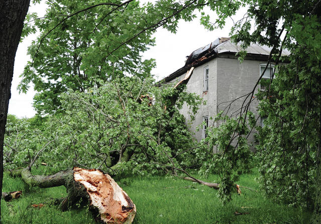 Mike Ullery | Daily Call Large trees on the ground and a heavily damaged roof on this home in the 4000 block of DeWeese Road in Staunton Township attest to the strength of the storms that hit Miami County on Wednesday evening.