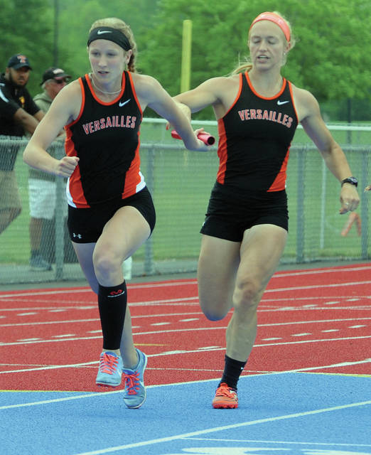 Mike Ullery | Daily Call Jenna Frantz hands off to Lucy Prakel in the 4x100 meter relay event.