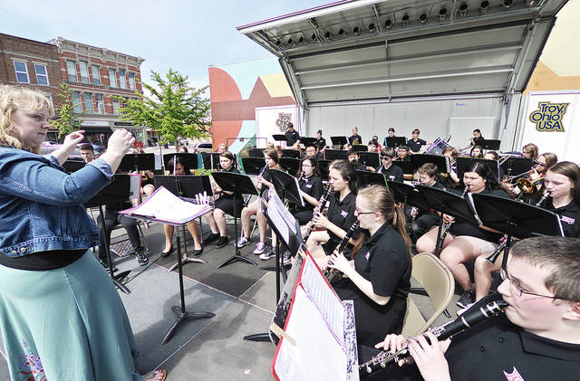 "Anthony Weber | Troy Daily News The Troy Junior High School eighth-grade band performs ""Command March"" under the direction Molly Venneman during Picnic on the Plaza at Prouty Plaza on Tuesday in downtown Troy. Thursday the seventh-grade band will perform at the same location beginning at 11:45 a.m., weather permitting."