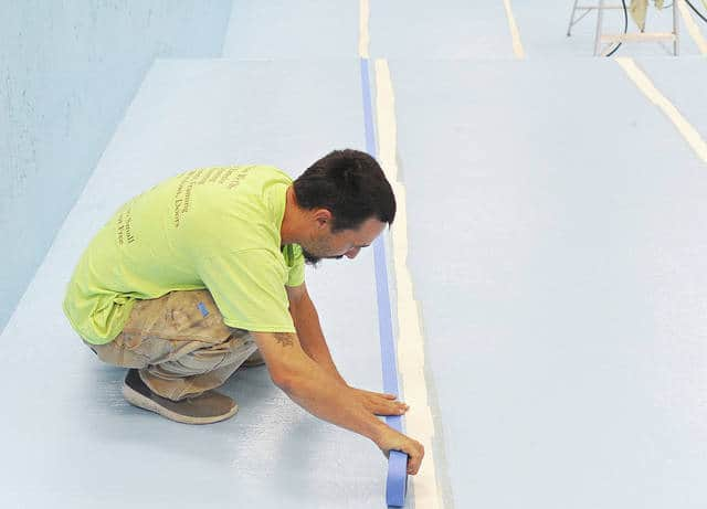Anthony Weber | Troy Daily News Zach Alder of Alder's Painting and Remodeling works on taping lines in the pool Thursday at Lincoln Community Center. Alder said he and his crew have been acid washing, caulking and painting the pool before it reopens the first week of June. According to executive director Shane Carter, the pool opened in 1939 and is important to the center. It is utilized by all ages, including senior citizens. He added that a lot of work has been done to the pool over the last several years to keep it updated. Any information regarding the facility can be found at www.lcctroy.com.