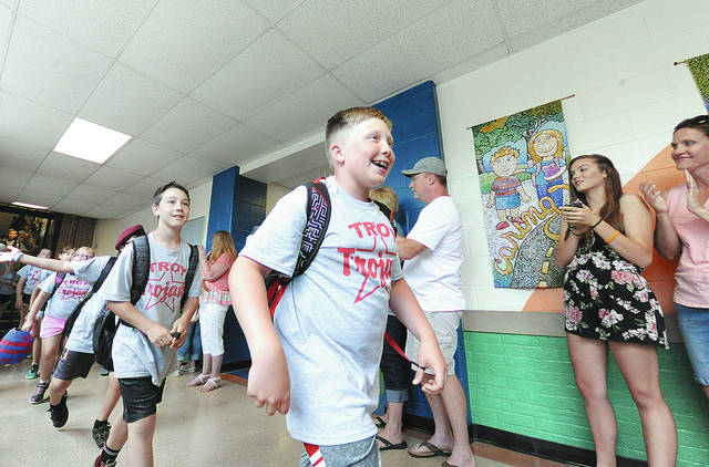 Anthony Weber | Troy Daily News Parents, students and staff clap for the out-going fifth-grade students at Concord Elementary School on Wednesday in Troy. Fifth graders walk through the halls and out to the bus a final time at the school. Area schools, including Troy, have come to the end of a school year for the summer.