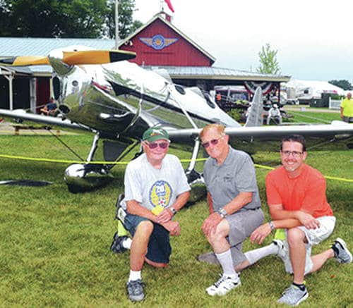 Provided photo Left to right, Bob Jacoby, Ted Teach and Doug Smith are shown with a 1935 Ryan ST aircraft for which Teach won the 2016 Antique Grand Champion award at the Experimental Aircraft Association (EAA) Air Show for restoring.