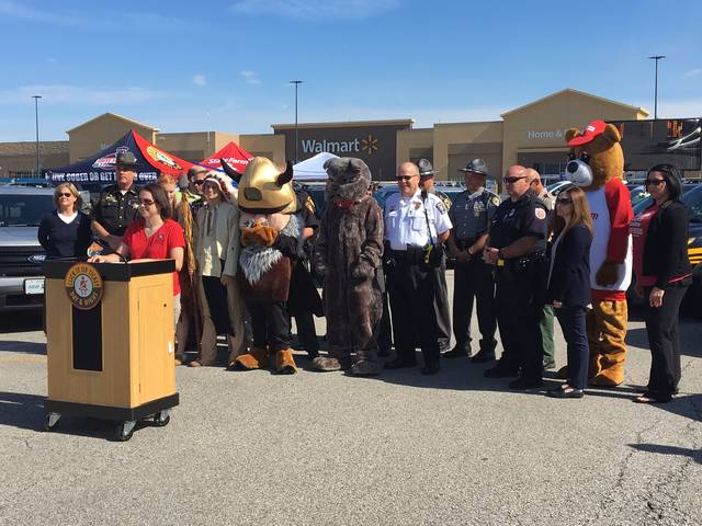 Vicky Knisley-Henry of Miami County Safe Communities speaks during the Click It or Ticket Campaign at the Piqua Walmart on Tuesday morning.