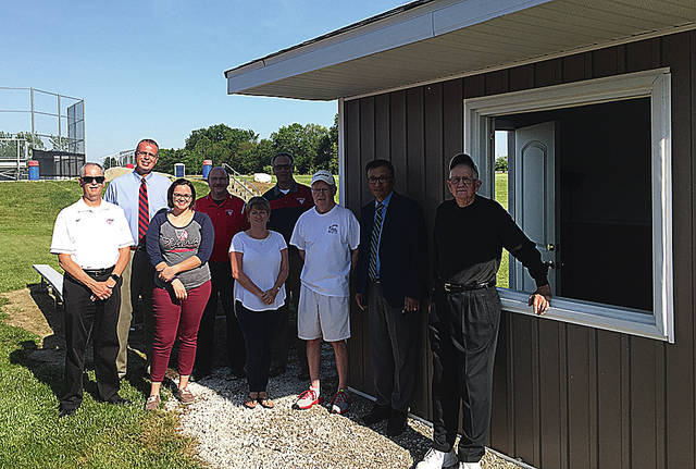 Photo Provided A ribbon cutting for the new Piqua High School tennis shed donated by Dr. Victor Kim and Bill Adkins was held recently.