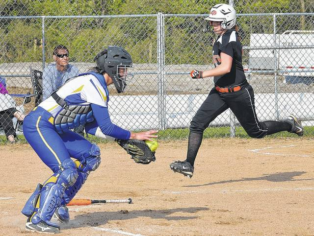 Luke Gronneberg/Civitas Media Lehman's Grace Monnin, left, catches a throw to home as Jackson Center's Kate Sosby races towards the plate at Jackson Center Tuesday.