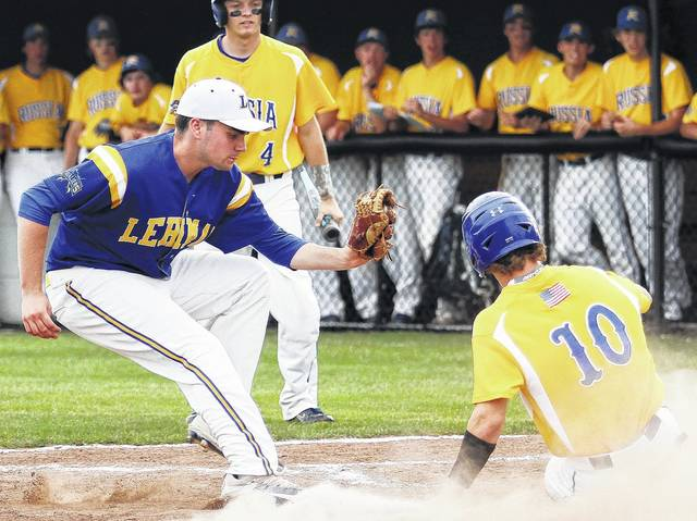 Luke Gronneberg/Civitas Media Lehman's Parker Riley, left, tries to tag out Russia's Drew Sherman who made it safely home at Sidney Wednesday. Luke Gronneberg/Civitas Media Russia's Drew Sherman is safe at home as Lehman Catholic pitcher Parker Riley looks to make a tag.
