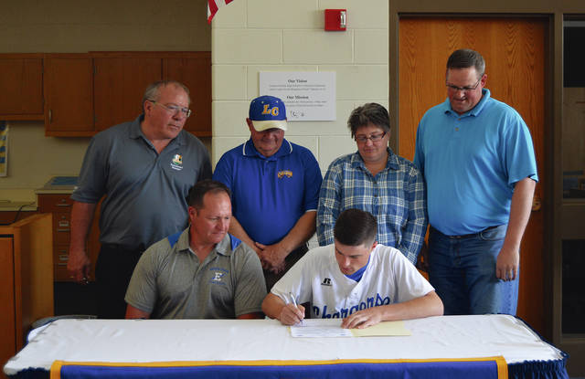 Rob Kiser/Call Photo Lehman Catholic senior Dylan Arnold signed his letter of intent this week to play baseball for Edison State Community College. In front with Arnold is Edison coach Scott Jones. In back are Lehman Catholic athletic director Richard Roll, Lehman Catholic baseball coach Dave King and Arnold's parents Jason and Sherry Arnold.