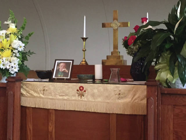 Provided photo A memorial altar is shown at a recent service at Piqua's Fusion church in honor of Zach McDaniel. The 16-year-old Piqua High School student died May 14 in a fishing accident.