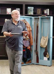 """provided photo Museum curator Terry Purke demonstrates """"History in a Box,"""" a new project that brings the history of American conflicts to life."""