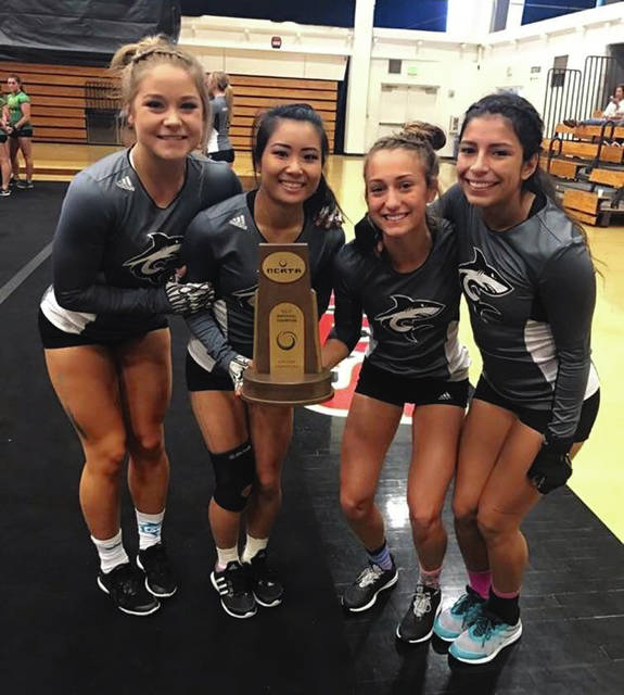 Photo Provided Ivee Kaye (second from right) and her teammates celebrate after winning the NCATA national title in Five-Element Acro for Hawaii Pacific.