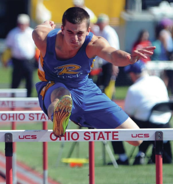 Mike Ullery | Daily Call Russia's Cole Tebbe runs the boys 110 meter high hurdles event in Division III state track in Columbus on Friday.
