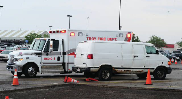 Mike Ullery | Daily Call Troy paramedics treat a reported 70 year old man in the parking lot of the Troy Walmart store on Monday afternoon after he called Miami County 911 for assistance, saying that he had overdosed on heroin, then self-administered Narcan. Medics transported the man to Upper Valley Medical Center for evaluation.