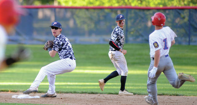Mike Ullery   Daily Call Sidney's Keeton McEldowney (1) slides into second base as Piqua's Howie Ludwig makes a throw toward second base Tuesday at Hardman Field.