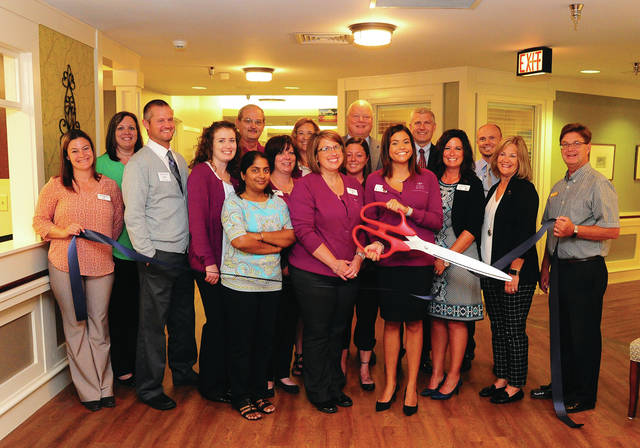 Mike Ullery   Daily Call Piqua Manor Nursing Home officials were joined by members of the Piqua Area Chamber of Commerce ambassadors for a ribbon-cutting event on Thursday, officially re-opening the newly renovated areas and the opening of the ventilator unit within the facility.