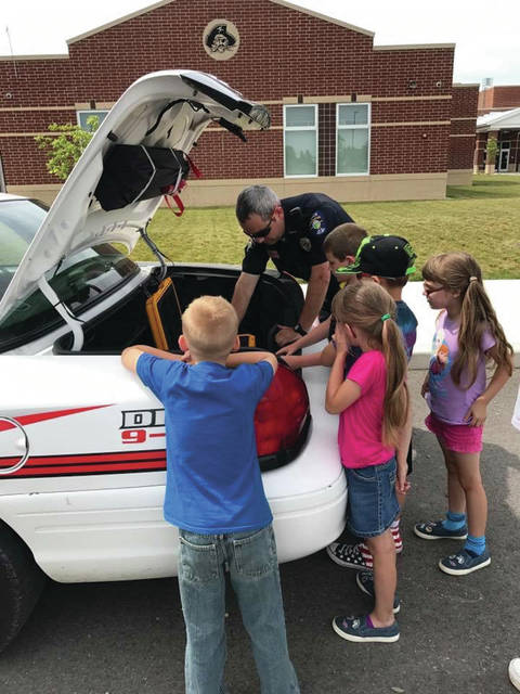 Provided photo School Resource Office Tim Kline teaches kids about different safety tools during the Covington Police Department's recent Safety Day.