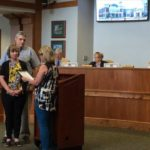 VIDEO: Commission honors resident, former employee