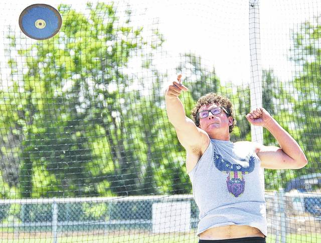 Houston junior David Stammen practices discus throwing in Houston Wednesday. Diagnosed with cancer less than two years ago, Stammen qualified last week to compete in the State Track Meet this weekend in Columbus.