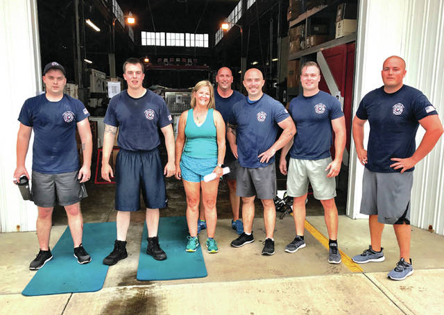 Provided photo Members of the Piqua Fire Department, along with Piqua Mayor Kazy B. Hinds, observed Firefighter Safety Stand Down Week (June 18-24), which focuses on up-to-date training, health and wellness.