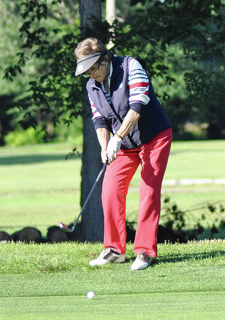 Rob Kiser/Call Photo Gail Brandewie chips on to the first green in the Tuesday Ladies League at Echo Hills.