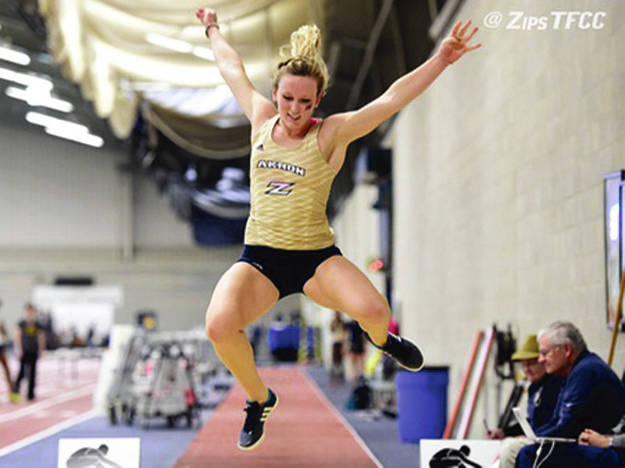Photo Provided By Akron University Jackie Siefring soars through the air in the long jump earlier this season.