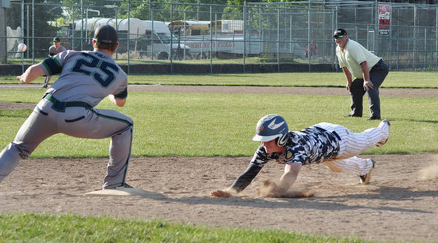 Rob Kiser/Call Photo Piqua Post 184's Will Eversole dives back into first base.