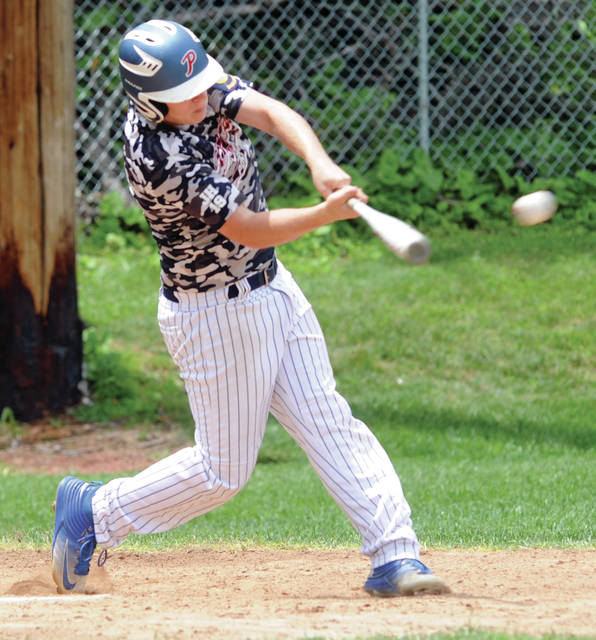 Mike Ullery/Call Photo Piqua Post 184's Travis Smith makes contact against Three Oaks on Saturday at Hardman Field.