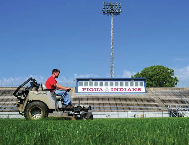Mike Ullery | Daily Call Maintenance crews mow the grass at Wertz Stadium in Piqua on Friday morning. As we head into the middle of July, Indians boys and girls soccer teams will be gearing up for the season.