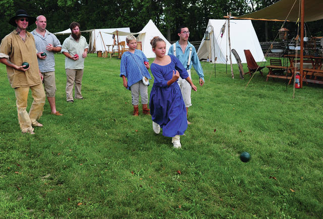 Mike Ullery | Daily Call Avery Helman, 10, of Bradford, makes her throw as Landon Helman, 10, Brant Helman, 15, Kelynn LeVeck, 13, of Pleasant Hill, Shannon LeVeck, Ben Campbell, and Jake Mohr play a game of Bocce Ball during Saturday's History Alive event at the John Johnston Farm & Indian Agency.