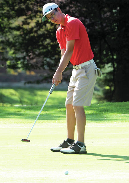Andrew Slusher looks to sink a putt at the Echo Hills Junior Club Championship this week.