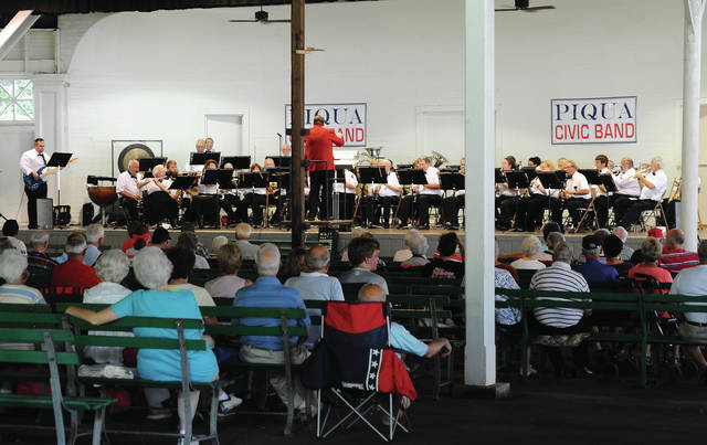 Mike Ullery | Daily Call The Piqua Civic Band celebrates <em>Heroes</em> during its Thursday concert at Hance Pavilion. The group, under the direction of Brett Poling, paid tribute to Heroes ranging from military men and women, to Superman, to Hogan's Heroes. The groups' next performance will be August 3, at 7 p.m.