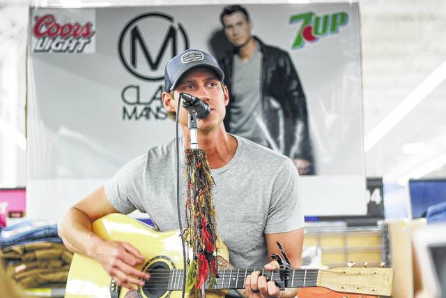 Clark Manson, of Covington and Nashville, Tennessee, performs in the Sidney Walmart, Thursday, July 6, 2017.