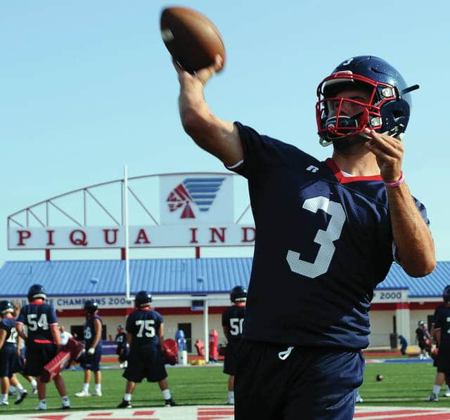 Mike Ullery   Daily Call Piqua quarterback Austin Davis, 3, throws long during a drill at Alexander Stadium/Purk Field on Tuesday morning.