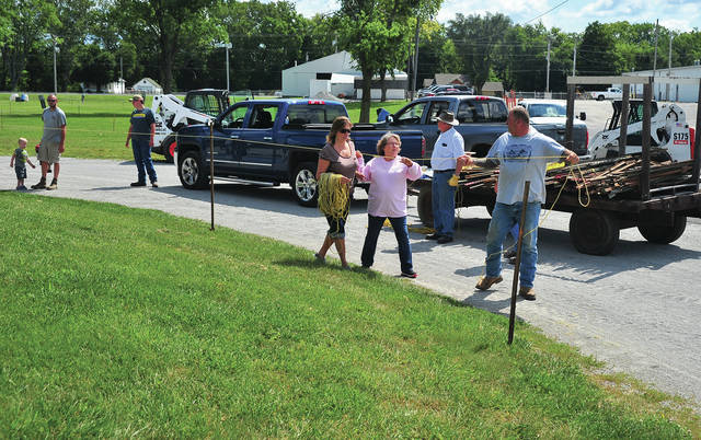 Mike Ullery | Daily Call Saturday was set-up day as Miami County Fair Board members spent the day at the Miami County Fairgrounds placing signs, roping off areas, and many other activities to get ready for the Miami County Fair which begins next Friday.