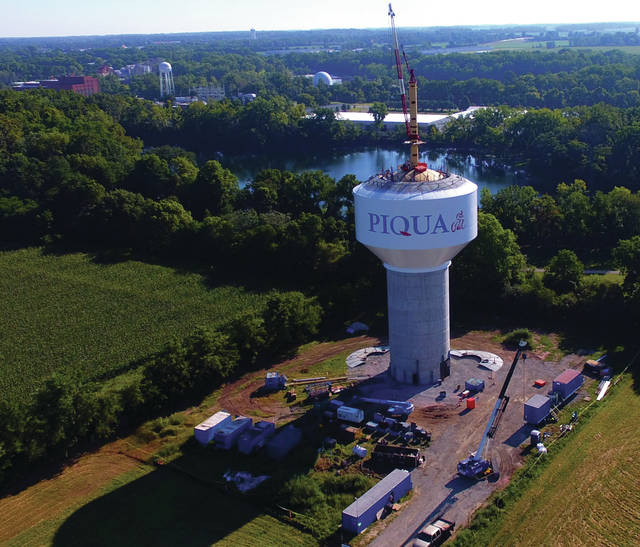 Travis Lowry, TRALOW Imaging | Contributed photo Construction crews lift the one-million gallon capacity bowl to the top of the new Piqua water tower under construction on Fox Drive. The top of the 400,000 pound steel bowl will sit some 180 feet above the ground. The project, which began in December of last year is scheduled to be completed in mid-October.