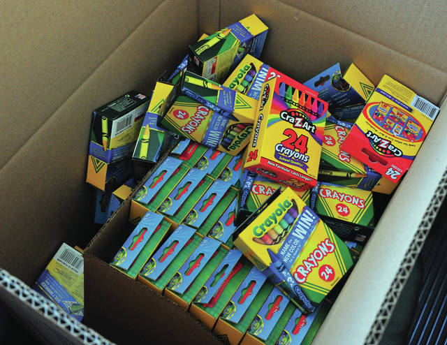 Mike Ullery | Daily Call Boxes of crayons are just a few of the items being donated to the Piqua Area United Way's Stuff the Bus school supply drive. The event also garnered glue, scissors, erasers, folders, pencils, pens and other items to be distributed in local schools.