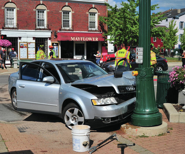 Mike Ullery | Daily Call Troy police investigate an apparent four-vehicle crash at that occurred on West Main Street near Cherry in the downtown area around 4:15 p.m.