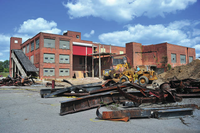 Mike Ullery | Daily Call Demolition has begun on the rear portion of the former Val Decker Meat Packing plant on East Ash Street. The building is owned by Lloyd Fry and houses several businesses, including the Piqua City Schools Board of Education offices.
