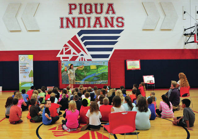 "Mike Ullery | Daily Call ""Sassafras Susan"" Condy, a naturalist with the Miami County Park District explains watersheds to a group of fourth-grade students at Piqua Central Intermediate School on Tuesday."