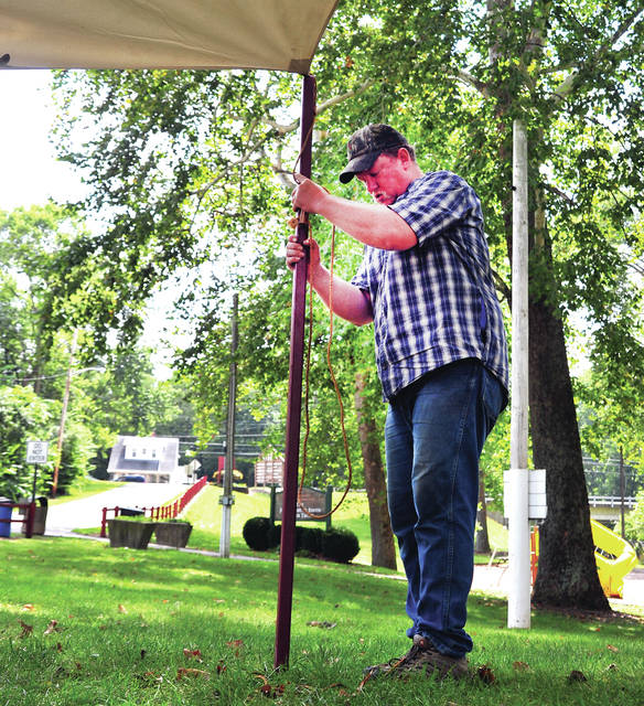 Mike Ullery | Daily Call Ramey Israel of Greenville sets a tent fly pole at the Covington Community Park on Wednesday as setup begins for the 25th anniversary of the Fort Rowdy Gathering. The event begins Saturday and runs through the Labor Day weekend in Covington Community Park. Israel will be operating a blacksmith shop at the Gathering.