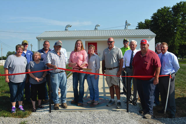Provided photo The Miami County Agricultural Society had a ribbon cutting ceremony Thursday for the new restroom facility on the grounds near the horse arena. The facility offers three women's stalls and three men's stalls — with two toilets and two urinals — with each side having handicapped accessibility at one stall. There also are three showers on each side for men and women, each again having one handicapped-accessible stall. Part of the money to build the facility came through an Ohio Department of Agriculture Capital Grant, which designated funding for improvements to fairgrounds throughout the state of Ohio in 2017. Mendenhall Builders of Troy was awarded the contract for the project.