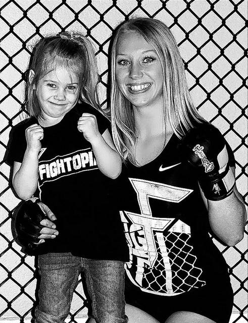 Chelsea Faulder, of Piqua, shown here with her 6-year-old daughter, Cheyenne, is set to make her professional debut	in the Mixed Martial Arts (MMA) competition Saturday.