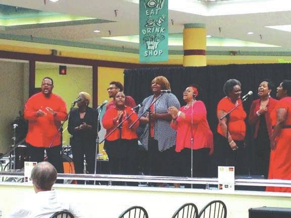 Sam Wildow | Daily Call file photo Members of Second Baptist Church sing at the Miami Valley Centre Mall during a past Church Fair. This year's fair will be at the mall on Aug. 19-20.