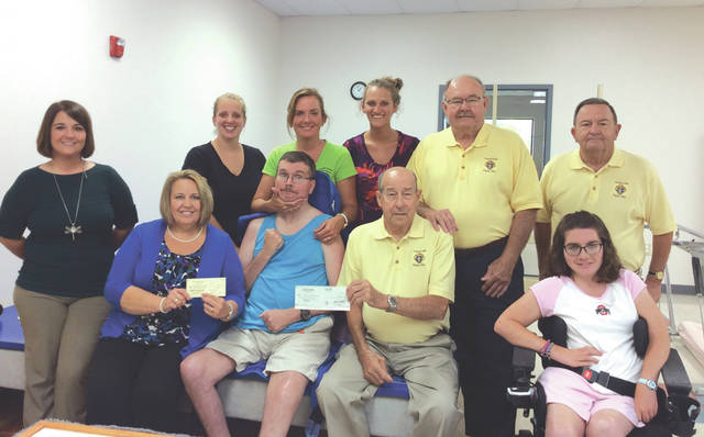 """Provided photo The Piqua Knights of Columbus, council #3344, presented a check from the annual """"Measure Up"""" campaign to their friends at the Rehabilitation Center/Nicholas School. The K of C are longtime supporters of the non-profit agency, which has been serving Piqua for over 45 years. Pictured are members of the Knights of Columbus along with staff and Rehab Center participants."""
