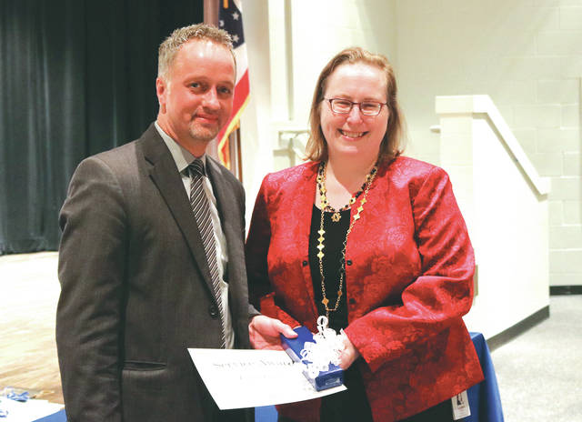 Provided photo Edison State Provost Christopher Spradlin honors Dr. Loleta Collins for 525 semester hours of employment at Edison State's recent adjunct faculty recognition banquet.