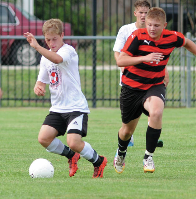 Mike Ullery | Daily Call Brandon Grissom protects the ball against Milton-Union Thursday at Wertz Stadium.