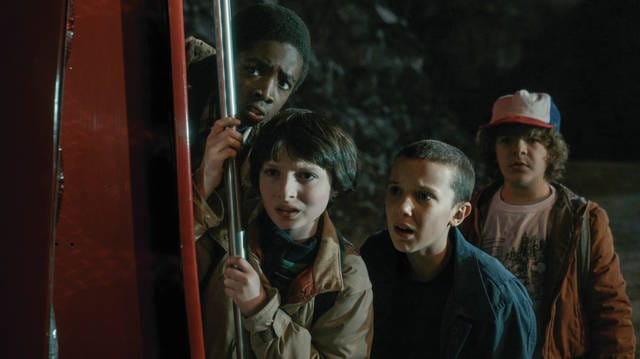 "Courtesy of Netflix Caleb McLaughlin, Millie Bobby Brown, Finn Wolfhard, and Gaten Matarazzo as Mike Wheeler, Lucas Sinclair, Eleven, and Dustin Henderson in ""Stranger Things"" as they stare at one of the many weird things happening on this show."