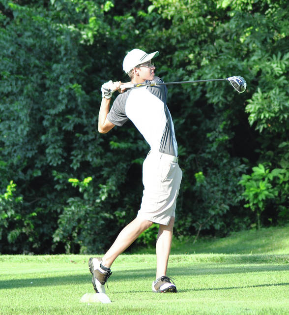Rob Kiser/Call Photo Covington's Andrew Slusher watches his tee shot on the second hole Wednesday at Echo Hills.